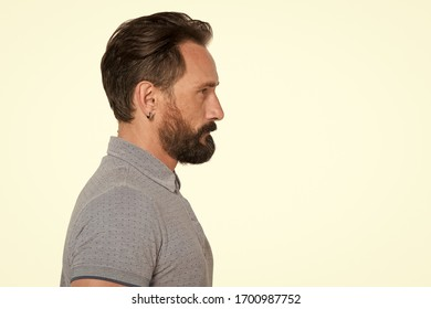 Calm handsome bearded man profile. Close-up bearded man profile with modern haircut. Portrait male aged profile