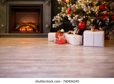 Calm image of empty wooden floor in front of decorated fireplace and Christmas tree. Place for text. Suitable for Christmas background.