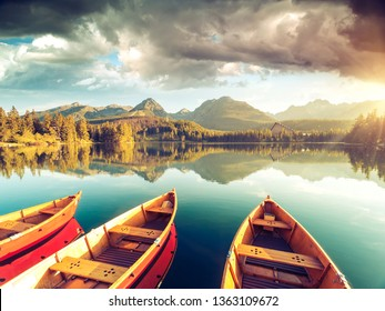 Calm lake in National Park High Tatra. Location place Strbske pleso, Slovakia, Europe. Photo toned style instagram filters, vintage effect. Scenic image of popular tourist attraction. Beauty of earth.