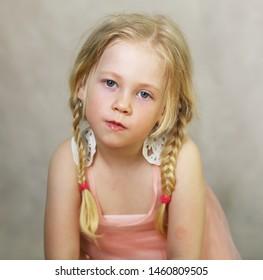 calm little girl looking at camera studio portrait