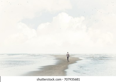 calm man walking in the sand between two seas
