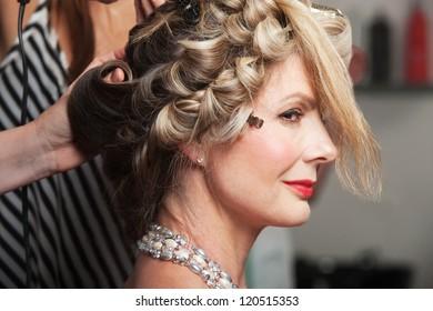 Calm mature Caucasian woman in beauty salon