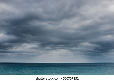 Calm and moody seascape with a dramatic sky before storm.