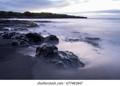 Calm morning on a black-sand beach