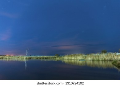 Calm night on the shore of the lake.