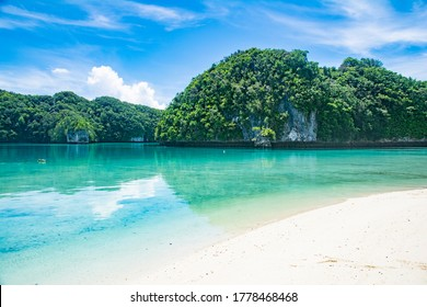 Calm Ocean, Shallow water, Lagoon, Green hills and Beach view of Omekang Island, Rock Island Southern Lagoon, Palau, Pacific, UNESC world heritage site