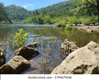 A calm part of the Emory River at Obed Wild and Scenic River National Park in Wartburg, Tennessee, near the bridge and Catoosa Road - Shutterstock ID 1794679246
