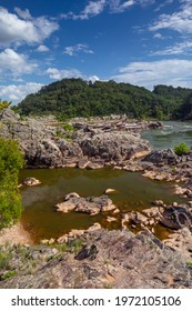The calm Potomac River surrounded by impressive Rocks at the Billy Goat Trail in the Great Falls National Park