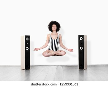 Calm pretty woman doing yoga exercise isolated on white background. Meditation music conceps.