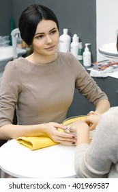 Calm professional. Vertical shot of a beautiful young female manicurist working at her beauty salon