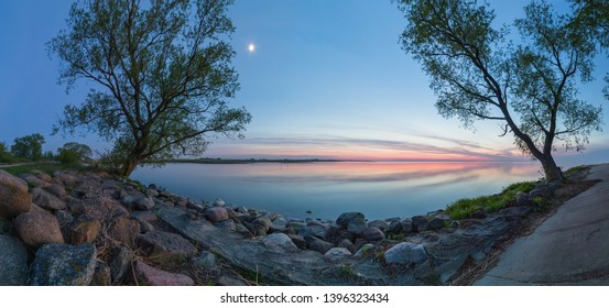 Calm and quiet sunset on the Baltic sea bay.