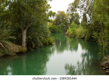 The calm running River Jordan at the Yardenit Baptismal Site the traditional place of John the Baptist and his ministry