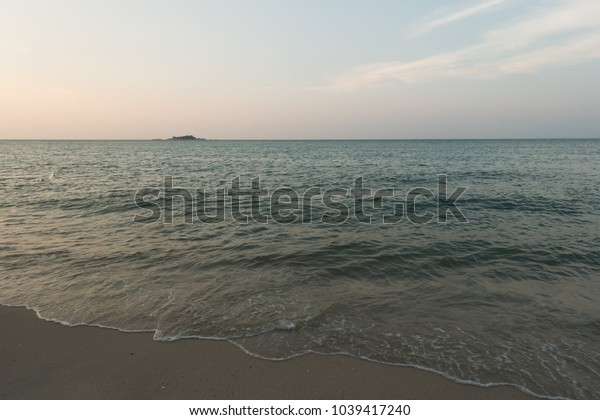 calm sea with blue cloudless skies in the evening