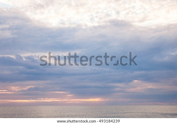Calm sea in the early cloudy morning.