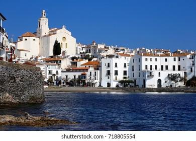 Calm sea and quiet white village of Cadaques, Catalonia, Spain, March 13, 2016