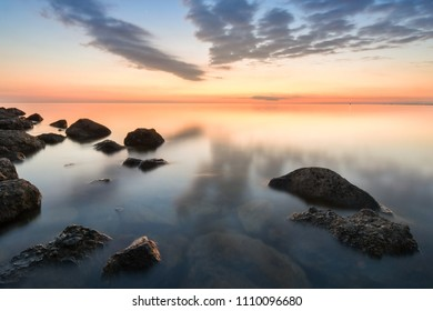 Calm sea of rocky beach of the Black Sea after sunset, Anapa, Russia