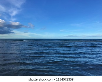 Calm sea under the evening sky with cloud and horizon, Huahin, Thailand