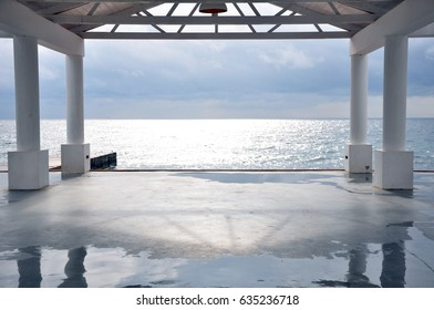 Calm sea and white gazebo