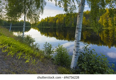 Calm summer evening by the lake