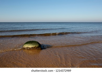 Calm sunny autumn Baltic Sea landscape with lonely stone