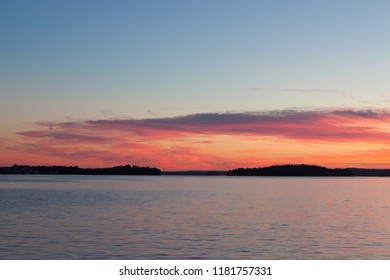 Calm sunset and clouds over lake in finland