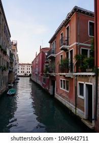 Calm Venetian Street. Narrow canal and old buildings, typical street view in Venice, Italy