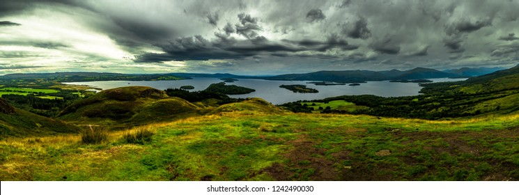Calm Water And Green Meadows At Loch Lomond In Scotland