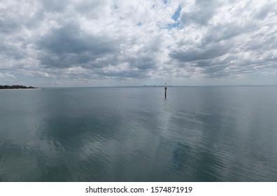 Calm water on a cloudy day Portarlington Victoria Australia