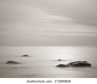 Calm water with rocks in the surface