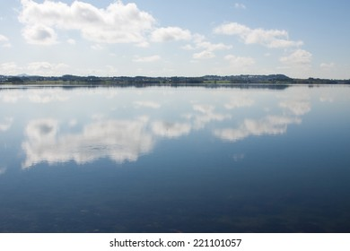 Calm waters giving a perfect reflection of the sky