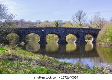 The calm waters River Quoile flow under the Quoile bridge on the outskirts of Downpatrick in County Down, Northern Ireland. Taken in early afternoon on a spring day in April 2019