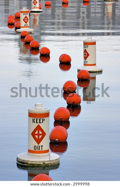 calm waters and several red buoys