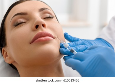 Calm woman during injection in face