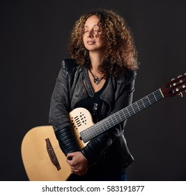 Calm woman with the guitar