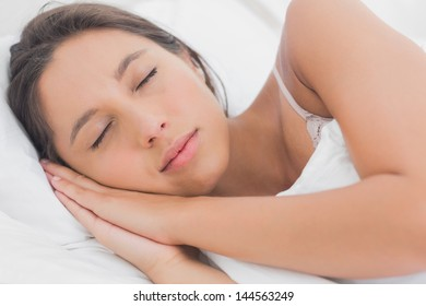 Calm woman sleeping in bed in the bedroom