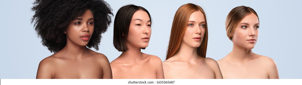 Calm young multiracial female models with naked shoulders and beautiful pure skin looking away on light gray background