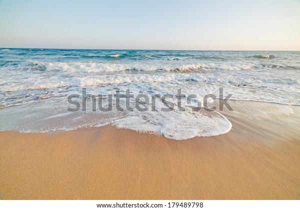 calmed sea in an empty beach