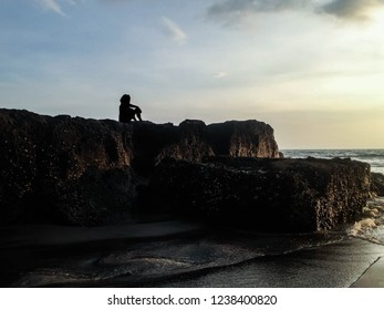 Calming The Mind On Sea Rocks In The Sunset Light At Batu Bolong Beach, Canggu Village, Badung, Bali, Indonesia