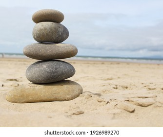 Calming stacked rocks on a beach.