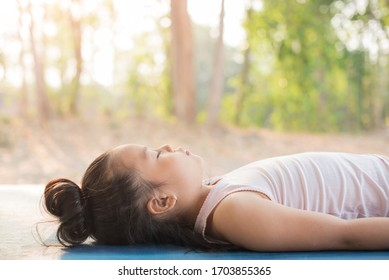 calmness and relax, female happiness.Horizontal, blurred background. little asian girl meditates while practicing yoga. freedom concept. calmness and relax, child happiness. toned picture healthy life