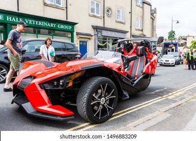 Calne, Wiltshire, UK, July 27, 2019. Red Polaris slingshot trike/tricycle
