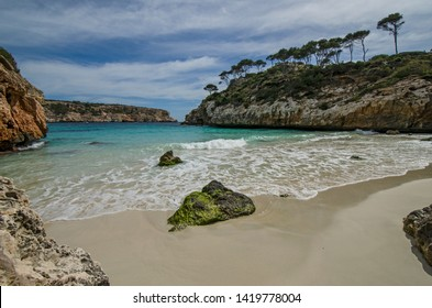 Calo des Moro, Majorca, Spain. This virgin beach, located between cliffs populated by pines, bushes and lentisc, is sandy, with some big rocks in between.