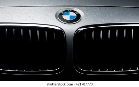 CALODYNE, MAURITIUS - APRIL 30, 2016 : Front picture of BMW car, closeup on logo and grill of silver BMW 3 series, with drops of water