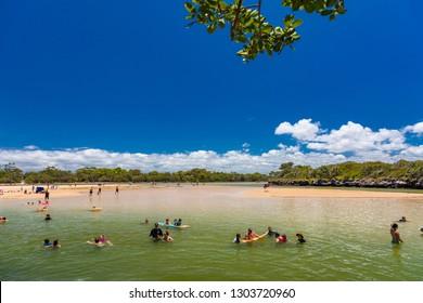 CALOUNDRA, AUS - Jan 20 2019: Hot sunny day at tropical Currimundi Lake Beach Calundra, Queensland, Australia