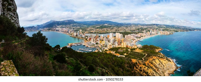 Calpe, Spain. Aerial view of Calpe, Costa Blanca at sunset. Popular summer resort in Spain with mediterranean sea and Las Salinas lake, mountains at the background