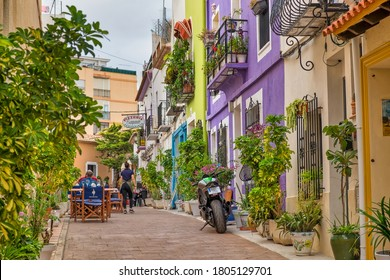 Calpe,Spain-August,04,2020; Street in the old town of Calpe with colorful houses and restaurant terraces.