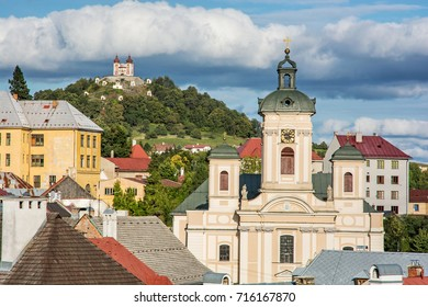 Calvary and Church of the assumption in Banska Stiavnica, Slovak republic. Sunset urban scene. Travel destination.