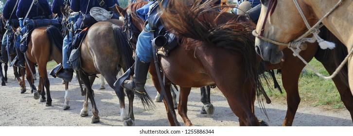 Calvary horsemen riding into town.