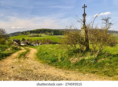 calvary over the village in a spring day