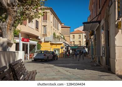 CALVI, CORSICA / FRANCE - OCTOBER 24, 2018: City street leading to the port